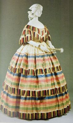 "Rather entertaining use made of un-matching coloured silk fringe here! Two-piece evening dress, made in New York circa Use this as inspiration for ""secession dress"" Victorian Gown, Victorian Fashion, Vintage Fashion, Antique Clothing, Historical Clothing, Vintage Gowns, Vintage Outfits, Two Piece Evening Dresses, 1850s Fashion"