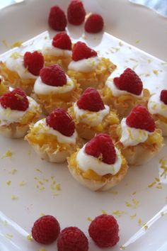 Mini Lemon Curd Phyllo Cups with Homemade Whipped Cream and Raspberries.