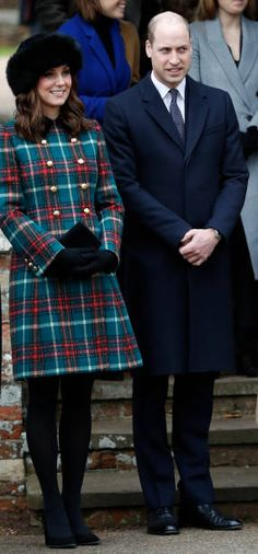 Britain's Catherine Duchess of Cambridge and Britain's Prince William Duke of Cambridge stand together as they wait to see off Britain's Queen...