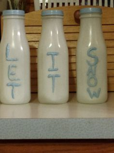 Starbucks bottles-used hot glue gun to write on then spray painted white then hand painted over the letters.