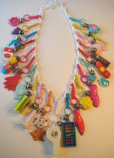 80's CHARM NECKLACE: Do you remember these? I definitely had the abacus sunglasses and phone and the cat but i remember him gray