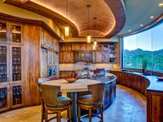 As seen on HGTV.com, designer Lori Carroll creates a beautiful Southwestern-style kitchen using color, pattern and texture inspired by gorgeous desert views.