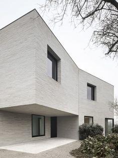 Die gestructureerde steen in combo met zwarte ramen en deuren  - GRAUX & BAEYENS architects, Jeroen Verrecht · house J-VC
