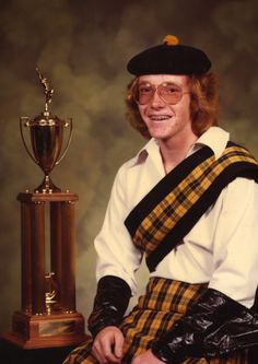Akward Family Photos - The award was for the 1979 Boulder High School marching band winning the best in the state. I played the snare drum, which was extra hard since I had to use one hand to keep my dress/kilt down in case a swift updraft whooshed by. Even though the outfit is gone, I still have the [...]