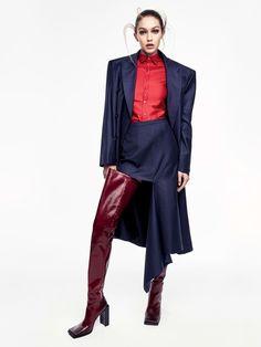 Gigi Hadid wears Balenciaga coat, shirt, skirt and thigh-high boots