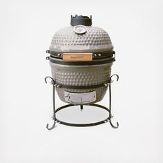 Grilling and roasting, baking and smoking, this grill offers a wide range of options. At just 23 inches tall, it's great for smaller porches and patios, along with being ideal for camping too. The ceramic shell produces high temperatures for searing, roasting and grilling but also allows for low-temperature smoking.  Features: Constructed for uniform heat circulation resulting in fast and consistent cooking The top ventilation cap allows to control the air with precision The thermometer on…