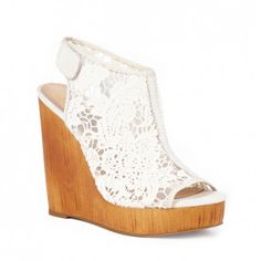 Crochet platform wedges by Lucky Brand. Stunning crochet design with a slingback Velcro strap and a wooden wedge.