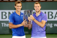 Vasek Pospisil of Canada and Jack Sock pose for photographers after defeating Simone Bolelli and Fabio Fognini of Italy during the doubles final on day thirteen of the BNP Paribas Open at the Indian Wells Tennis Garden on March 21, 2015 in Indian Wells, California.