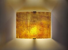 Exotic amber glass wall sconces  made of fused glass by Galilee lighting. #modernartglass #modernartglasslighting #fusedglasslights #artwalllights