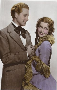 """Jeanette MacDonald and Nelson Eddy on a color postcard from Maytime. Back of the PC states: """" Film Partners Series. No. PC 221.This is a Handcoloured Real Photograph"""" - ESCANO COLLECTION"""