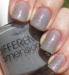 White Dwarf is a grey shimmer polish with added rainbow flakies. Opaque in 2 to 3 coats.    Swatches courtesy of thepolishaholic.com,