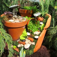 2013 Boston Flower Show  Clever idea for using an old broken clay pot.