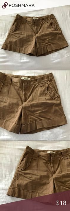 Banana Republic Martin Fit dark khaki shorts sz 8 These classy cuffed shorts from Banana Republic are a nice, neutral dark khaki color. There is stretch in them. Measurements are shown in the pictures. They are in EUC with no holes, stains, or rips. Bundle with other items from my closet for the best deal! Banana Republic Shorts