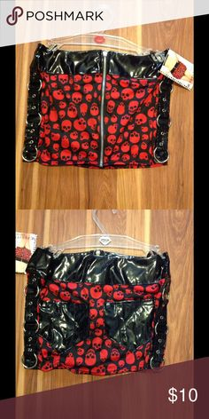 """Edgy Rocker Skull Mini Skirt This skull mini skirt has patent leather waist, side with silver rings, and back pockets. Has zipper up front. Made of 80% nylon 20% spandex. Approximate measurements waist 14"""" length 11"""". Coquette Darque Skirts Mini"""