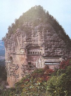 """Located Southeast of Tianshyui City in Gansu Province on a 142 meters high hill named Maijishan, meaning """"Wheat-pile Hill"""". Work on the grottoes started in the late 4th century and continued through successive North Wei (386-534 A.D.) and Song (960-1279 A.D.) dynasties until the 19th century. There are 194 existing caves, in which are preserved more than 7,000 sculptures made of terra cotta and over 1,000 square meters of murals. Earthquakes, rain and fire have damaged a large part of the…"""