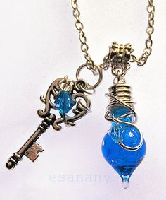 I really like this. I am trying to decide if I want to order it.  Mana Potion - Vibrant Blue Potion - Silver Vial Necklace. $ 21.50, via Etsy.