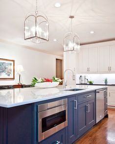 Long blue kitchen island with mixed metals designed with a white quartz countert. Long blue kitchen island with mixed metals designed with a white quartz countertop, brass pulls and stainless steel appliances. Kitchen With Long Island, White Kitchen Island, Long Kitchen, Kitchen Island With Seating, Kitchen Islands, Rustic Kitchen, White Shaker Kitchen, Shaker Kitchen Cabinets, Quartz Kitchen Countertops
