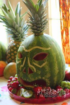 Need creative ideas for a Hawaiian Luau or tropical theme party?  Unique decorations using a tiki carved watermelon, watermelon whale, tiki bar, roasted pig and beautiful fruit trays.