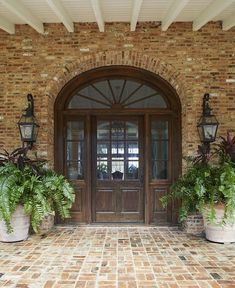 Farmhouse Exterior: Oversized reclaimed Cypress front door, with an elliptical transom and sidelites, adds a traditional but casual element. Oversized Terracotta Planters with Lush Ferns Southern Farmhouse, Farmhouse Front, Southern Homes, Country Farmhouse Decor, Southern Living, Country Living, Farmhouse Furniture, Rustic Cottage, Country Chic