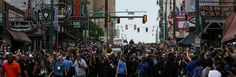 A huge crowd follows the funeral hearse as it slowly moves down Beale Street.