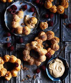 Choux wreaths with burnt-honey cream, raspberries and sesame praline recipe :: Gourmet Traveller