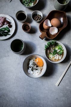 A traditional japanese breakfast of tamago kake gohan (japanese rice and egg bowl) with furikake and a side of yuzo miso soup. Easy & quick vegetarian comfort food recipe!