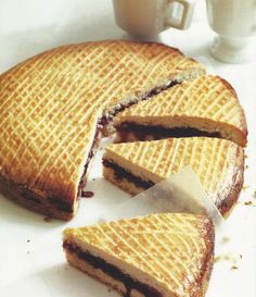 Gâteau Basque is a traditional dessert from the Basque region of France. Typically Gâteau Basque is constructed from layers of an almond flour based cake with a filling of either pastry cream or preserved cherries.