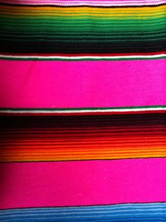 mexico. neon. blanket.  Could prolly steal one off a Los Aztecas table.