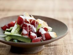 Samoan-Style Tuna-and-Cucumber Salad | For his Samoan-Style Tuna-and-Cucumber Salad, Andrew Zimmern tosses cubes of silky raw tuna in a vibrant coconut dressing spiked with lime and chile oil.