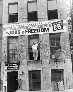 Cleveland Robinson standing on second floor balcony of the National Headquarters of the March on Washington in Harlem, pointing to a banner announcing the march, 1963 National Civil Rights Museum, Jim Crow, Oral History, Alternate History, Civil Rights Movement, I Have A Dream, My Black Is Beautiful, Library Of Congress, African American History