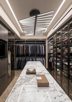 A master closet with a fun lighting fixture- ELLEDecor.com Walk In Closet Design, Bedroom Closet Design, Closet Designs, Home Decor Bedroom, Master Bedroom, Master Suite, Master Closet Design, Bedroom Brown, King Bedroom