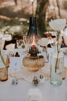 DIY Wedding Centerpieces: Tips and How-To - Put the Ring on It Oil Lamp Centerpiece, Lantern Centerpieces, Wedding Table Centerpieces, Wedding Flower Arrangements, Diy Wedding Decorations, Reception Decorations, Table Decorations, Centerpiece Flowers, Centerpiece Ideas