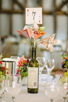 table numbers with origami and wine bottles - Hochzeit auf dem Land in Cambridgeshire von Ann-Kathrin Koch   Hochzeitsblog - The Little Wedding Corner