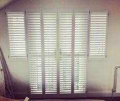 Work in progress - shutters installation of full height panels with mid rail for a balcony door and two small windows, California range with rear side mechanism for modern and clean cut look • #window #balcony #door #frenchdoors #styling #interior #design #modern #look #home #trends #white #finish #California #range #decorating #ideas #windowtreatments #windows #shutters #solid #wood #design #manufacture #installation #london #workinprogress •