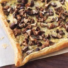 Goat Cheese, Leek and Mushroom Tart Recipe with unsalted butter, leeks, fresh thyme leaves, bay leaf, chicken stock, salt, freshly ground pepper, crème fraîche, soft goat's cheese, cremini, chanterelle, mixed mushrooms, all-purpose flour, puff pastry