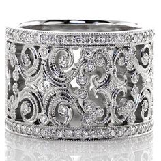 Caledonia - Caledonia is a sensational ring fashioned from large, intricate filigree curls and diamonds. The edges of the pattern are textured with milgrain to refine the look, and there are small bezel set diamonds throughout the band. Each edge of the band is finished with a row of micro pavé to frame the design.