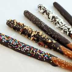 "Chocolate Covered Pretzel Sticks-- gives me an idea for chocolate ""sparklers"" for 4th of July - peppermint, sprinkles [different kinds], peanuts"