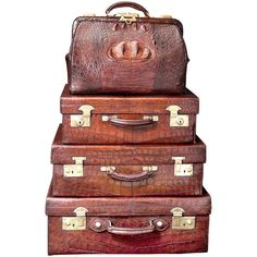 Vintage English Crocodile Luggage Collection | From a unique collection of antique and modern trunks and luggage at http://www.1stdibs.com/furniture/more-furniture-collectibles/trunks-luggage/