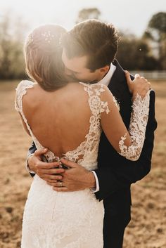 Vintage Florida wedding featuring a long sleeve lace wedding dress with cathedral train by designer Martina Liana