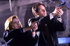 """The X-Files  ... Agent Scully (Gillian Anderson) and Agent Mulder (David Duchovny) may have worked out of a basement office at FBI headquarters in D.C. — but their attention was really focused on otherworldly, unexplained phenomena. """"The X-Files"""" ran for nine seasons.    David Gray / Fox"""