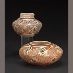 Two Hopi polychrome jars. Nampeyo family, the larger by Fannie, the smaller by her daughter Elva, each painted in a winged migration pattern.