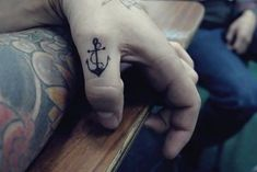 Rib small but cute tattoo design for girls. Anchor tattoo behind the ear. Anchor tattoo on ankle. Anchor tattoo on upper back. Anchor Finger Tattoos, Anchor Tattoo Men, Thumb Tattoos, Small Anchor Tattoos, Love Tattoos, Body Art Tattoos, Small Tattoos, Tattoos For Women, Tattoos For Guys
