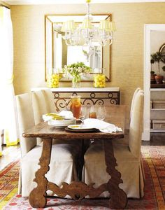 Dining Room --  Gold, beveled, mirror, carrara, marble, black, iron, console table, wood, dining table, linen, cotton, slipcovered, chairs, silver, chandelier, gold, silk, shades, red, orange, yellow, rug, gold, beige, grass cloth, grasscloth, wallpaper,