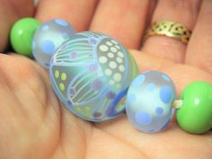 Springtime lampwork / glass focal bead    - SRA Homemade Cosmetics, Glass Etching, Lampwork Beads, Spring Time, Lilac, Color Schemes, Glass Beads, Turquoise, Handmade