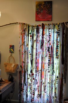 """This is one angle of my new 'creative room"""" I made this curtains from scraps fo fabric, lace, ribbon, and Yo-Yo's that I made from my grandmother when I was 16..."""