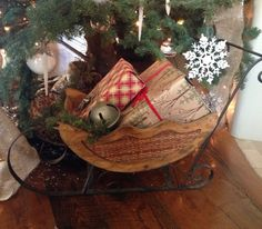 Sleigh from #Goodwill, under the #Christmas tree, filled with gifts.  #thrift #home #rustic