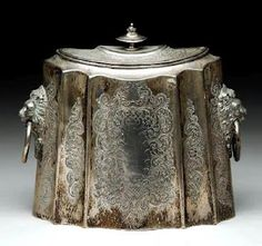 silver tea caddy, mine is based on this design; delighted to find!