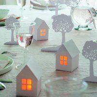 Des photophores en forme de maisonnettes en papier
