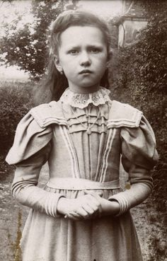 This little Victorian girl reminds me of Mary Lennox when she first came to Misselthwaite Manor...The Secret Garden.