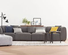 The Kelsey 5-piece modular sectional offers countless seating arrangements and ultimate versatility. Each piece features a low-profile design with deep seated, down blend cushions and block legs for ultimate lounge style.  With its unique modularity, build a custom sectional arrangement to fit your personal space.  Purchase online at SCANDIS.com
